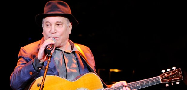 Paul Simon performing on stage