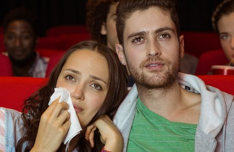 Couple crying over a film in a cinema