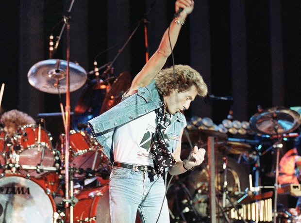 Roger Daltry singer of The Who performing on stage