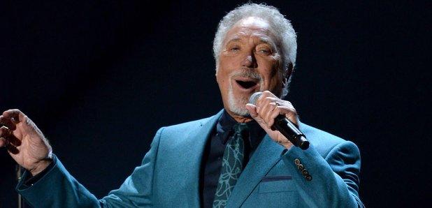 Tom Jones singing on stage