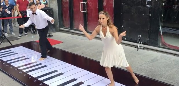 Couple dancing on giant keyboard