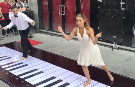 Couple dancing on giant keyboard